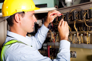 male electrician test the machine
